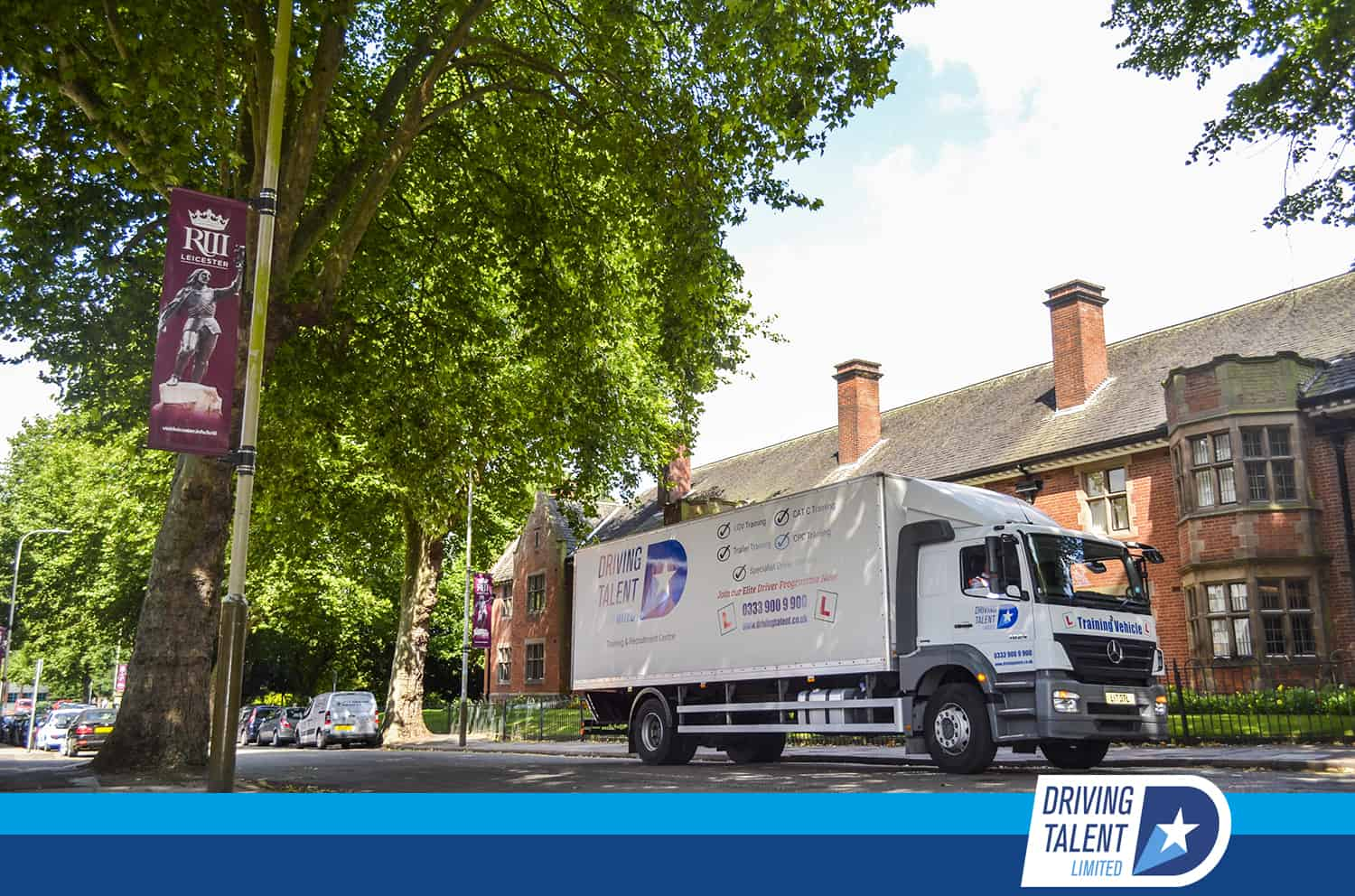 truck driving down street - driver shortage - Category C Class 2 Training in Derby