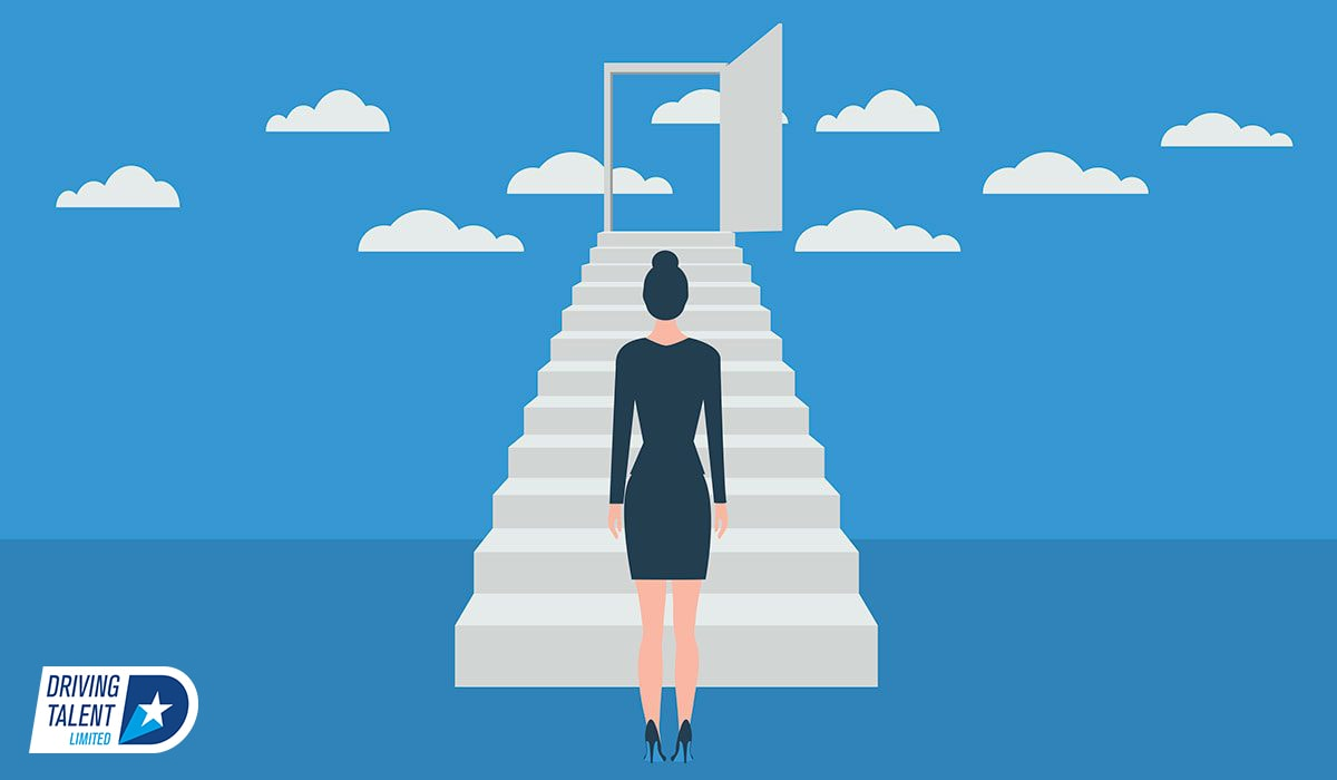 woman walking up staircase to clouds